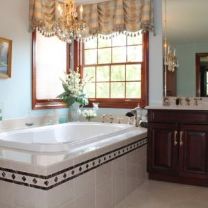 Master Bathroom With Granite Tub Surround and Countertops